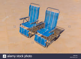 Two Blue Nylon Stripe Foldable Recliner Deck Chairs In An ... Weatherly Folding 6position Teak Deck Armchair Havana Bronze Adjustable Foldable Chair 5position Aqua Metal Beach Charles Bentley Fsc Eucalyptus Wooden Orange Retail Sales Direct Britannia 8position Steamer Lounge Oiled Finish Graydon Recling With Cushion Amazoncom Chair Outdoor Portable Transabed Cushions Canvas Deck Alinum Heavy Duty Widen Aosom Outsunny Sling Fabric Patio Chaise 5 Position Cream White Rakutencom Harbour Housewares Blue Stripe