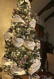 tree decorations ideas with ribbons don t stop at ornaments these tree decorating ideas are even