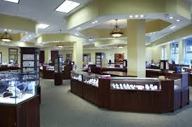 Fabulous LED Lighting For Modern Jewelry Shop Design With Wooden Display Cases And Unique Ceiling