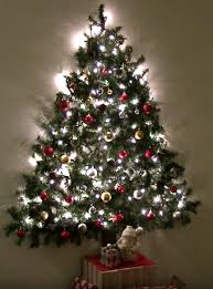 Christmas Tree Watering Device Homemade by Wall Mounted Christmas Tree Saves Space By Attaching Garland U0026 Lights