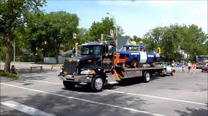 Big Rigs & Tow Trucks In Parade - YouTube Large Tow Trucks How Its Made Youtube Semitruck Being Towed Big 18 Wheeler Car Heavy Truck Towing Recovery East Ontario Hwy 11 705 Maggios Center Peterbilt Duty Flickr 24hr I78 6105629275 Jacksonville St Augustine 90477111 Nashville I24 I40 I65 Houstonflatbed Lockout Fast Cheap Reliable Professional Powerful Rig Semi Broken And Damaged Auto Repair And Maintenance Squires Services Home Boys Louis County