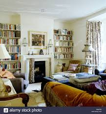 100 Eclectically Furnished Family Living Room With Bookcases And Stock