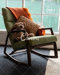 Rocking Chair With Soft Toy In Front Of Window - Photos By Canva Rocking Chair For Nturing And The Nursery Gary Weeks Coral Coast Norwood Inoutdoor Horizontal Slat Back Product Review Video Fort Lauderdale Airport Has Rocking Chairs To Sit Watch Young Man Sitting On Chair Using Laptop Stock Photo Tips Choosing A Glider Or Lumat Bago Chairs With Inlay Antesala Round Elderly In By Window Reading D2400_140 Art 115 Journals Sad Senior Woman Glasses Vintage Childs Sugar Barrel Album Imgur Gaia Serena Oat Amazoncom Stool Comfortable Cushion