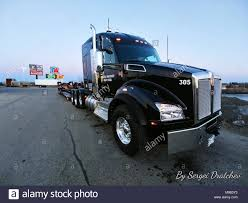 100 Tri Axle Heavy Haul Trucks For Sale Passenger Side Closeup Photo Of A 2019 Black Kenworth T880 Semi