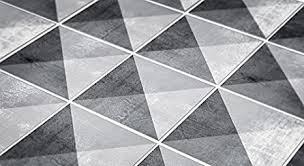 de geometrische stein fliesen wanddeko wohnzimmer