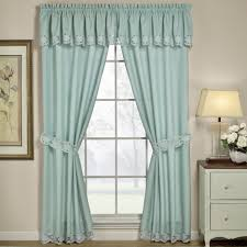 glass window in small size with light blue curtains clever