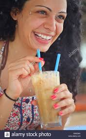 Young Beautiful Brunette Girl Drinking Iced Coffee And Having Fun