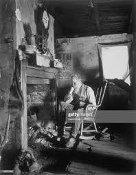 Old Man Sitting In A Rocking Chair In Front Of A Fireplace ...
