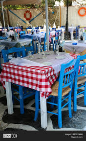 🔥 Typical Greek Tavern With Blue Chairs And Tables With ... Tables Old Barrels Stock Photo Image Of Harvesting Outdoor Chairs Typical Outdoor Greek Tavern Stock Photo Edit Athens Greece Empty And At Pub Ding Table Bar Room White Height Sets High Betty 3piece Rustic Brown Set Glass Black Kitchen Small Appealing Swivel Awesome Modern Counter Chair Best Design Restaurant Red Checkered Tisdecke Plaka District Tavern Image Crete Greece Food Orange Wooden Chairs And Tables With Purple Tablecloths In