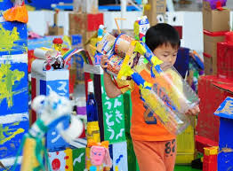 A Boy Places His Robot Made Of Recycled Meterials To The Display Zone In Tokyo Capital Japan May 3 2010