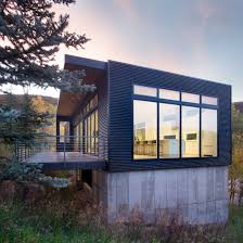 100 Mountain Home Architects Rowland Broughton Nestles Rectilinear Home Into