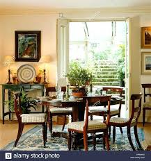 A Country Style Dining Room With French Doors Leading Outside On Interior 48 X 80 6