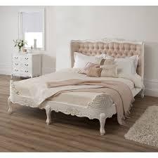 wondrous white finished wooden king size upholstered tufted bed
