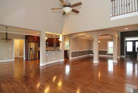 Open Layout Between The Great Room Kitchen And Formal Dining Island With Columns Serving Bar Facing