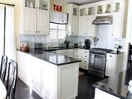 Modern Style Antique White Kitchen Cabinets With Black Appliances