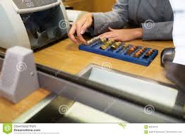 Clerk counting cash money at bank office Royalty Free Stock