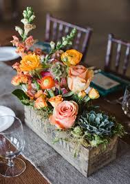 Try This Unexpected Take On A Centerpiece Plant Your Stems In Aged Wood Boxes