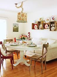 Example Of A Cottage Chic Medium Tone Wood Floor Dining Room Design In Chicago With White