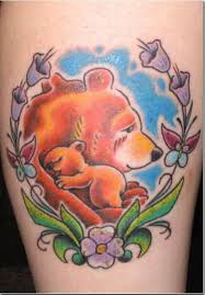 Sweet Mother Hold Cute Baby Bear Tattoo With Flowers