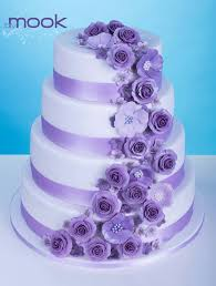 Wedding Cake With Purple Flowers Photo