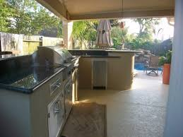 Marvelous L Shaped Outdoor Kitchen Kits With Polished Black Granite Galaxy For Countertops And