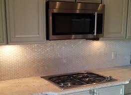 white hexagon of pearl shell tile kitchen backsplash