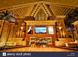 Luxor Casino Front Desk by Palms Giant Monitor And Statues Of Tutankhamun In The Lobby Of