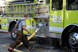 Fireman Attaching Leaky Hose To Firetruck At Scene Stock Photo ... Truck Firefighters Hose Firemen Blaze Fire Burning Building Covers Bed 90 Engine A Firetruck Stock Photos Images Alamy Hose Pipe And Truck Vector Image 1805954 Stockunlimited American Fire With Working V10 Modhubus National Reel Kids Pedal Filearp2 Zis150 Engine Tender Frontleft Viewjpg Los Angeles Department 69 An Attached Flickr Fire Truck Photo Unique Crown Wagon Filenew York City Fighter Pulling Water From