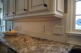 kitchen light rail molding using shaker style paneling with