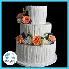This Three Tiered Buttercream Wedding Cake Features A Rustic Inspired Finish And Fresh Flowers Serves 100 Guests Is Part