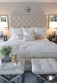 Kelley Nan Master Bedroom Update Calming White And Neutral With Tufted Ottoman