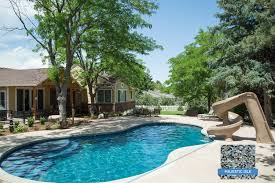 Npt Pool Tile Palm Desert by Slide In To This Inviting Pool Finished With Our Smooth Pebble