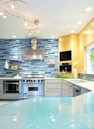 modish white cabinets set with blue mosaic wall tile backsplash as