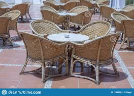 Rattan Table And Chairs In Beach Cafe Next To The Red Sea In ... 315 Round Alinum Table Set4 Black Rattan Chairs 8 Seater Ding Set L Shape Sofa Brown Beige Garden Amazoncom Chloe Rossetti 17 Piece Outdoor Made Coffee Table Set Stock Photo Image Of Contemporary Hot Item Modern Fniture Stainless Steel And Lordbee Large 5 Pcs Patio Wicker Belleze 3 Two One Glass Details About Chair Cushion Home Deck Pool 3pc Durable For Pcs New Y7n0