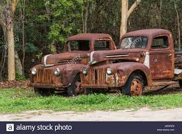 Two Old Abandoned Rusty Ford Trucks Stock Photo: 135155221 - Alamy Ford Old Pickup Truck Classic American Trucks History Of Ford Trucks Archives Classictrucksnet Motor Company Timeline Fordcom The Old Truck 1972 F100 Youtube Best Image Kusaboshicom 1950 F1 Farm 81979 Bronco A Classic Built To Last Picking Up The Pieces A Wsj 1948 Pickup Hot Rod Network 12 Pickups That Revolutionized Design 1956 Kick Ass Get Worth Water Written By Anne E