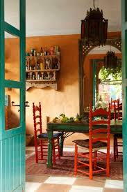 Green And Orange Mexican Style Kitchen With Dining Table