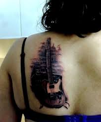 A Well Detailed Guitar Tattoo On The Back From Shape To Shadows Of