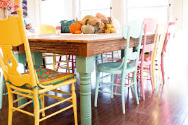 Pastel Colored Wooden Kitchen Table And Chairs In A Boho Chic