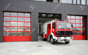 Emergency Fire Rescue Truck. Fire-fighting Vehicle On Fire-station ...