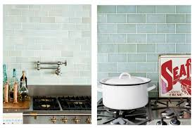 variation in subway tile color will all white cabinets and