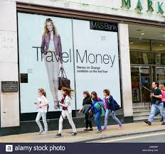bureau de change york marks and spencer travel advertisement in a store window