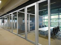 100 Sliding Exterior Walls Increase Productivity And Communication With Frameless Glass Doors