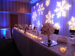 Head Table For A Winter Wonderland Wedding With Snowflake Gobo Backdrop Sequin Linen