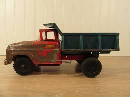 Old Tonka Red And Green Pressed Metal Dump Truck Toy- Rustic ... Amazoncom Tonka 93922 Classic Steel Crane Vehicle Toys Games Toystate Caterpillar Metal Machines 797f Dump Truck Cstruction Equipment Tonka Mighty Diesel Pressed Steel Metal Cstruction Dump Truck Ts4000 Amazoncouk Mighty With Bonus Tools Big W Mighty Toy 1960s Pressed Large Pictures Dump Truck 768metal10 By 16 Classics Mightiest At Ape Australia Canada