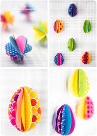 Multicolored Egg Decorations Made From Patterned Paper In Different Colors Folded And Stuck