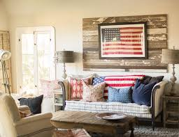 A Neutral Color Scheme And Rustic Pallet Backdrop Make The Framed American Flag Hanging In This