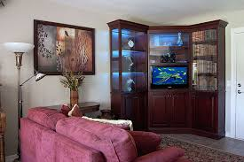Corner Wall Unit For Flat Panel TV Features Matching Bookcase And Display Cabinet