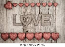 Valentines Day Hearts On Rustic Wooden Background With The Word