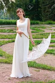 beautiful happy smiling in white dress with decorative