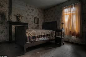 Religious Layers Of Blankets Remain On The Bed In Empty Farmhouse Which Is